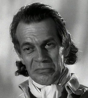 The Prosecutor - played by Raymond Massey