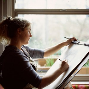 Woman drawing on easel